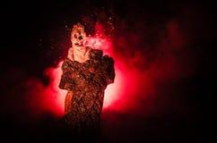 Θηλυκός δαίμονας Ερχομός δαιμόνων Slhouette του αριθμού διαβόλων ή τεράτων για ένα υπόβαθρο της πυρκαγιάς Στοκ φωτογραφίες με δικαίωμα ελεύθερης χρήσης