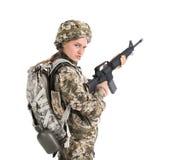 Θηλυκός στρατιώτης με το πολυβόλο Στοκ Εικόνες