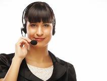 Θηλυκός χειριστής υποστήριξης πελατών με την κάσκα και το χαμόγελο Στοκ Φωτογραφία