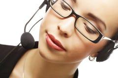 Θηλυκός χειριστής υποστήριξης πελατών με την κάσκα και το χαμόγελο Στοκ εικόνα με δικαίωμα ελεύθερης χρήσης