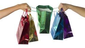 θηλυκό αρσενικό χεριών giftbags Στοκ Φωτογραφίες