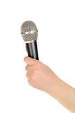 θηλυκό μικρόφωνο χεριών Στοκ φωτογραφία με δικαίωμα ελεύθερης χρήσης