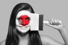 Θηλυκό στα εθνικά χρώματα της Ιαπωνίας Στοκ φωτογραφίες με δικαίωμα ελεύθερης χρήσης