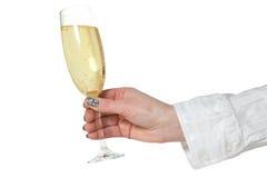 θηλυκό χέρι γυαλιού σαμπάνιας Στοκ φωτογραφία με δικαίωμα ελεύθερης χρήσης