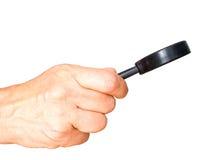 Θηλυκό χέρι με την πλάγια όψη που ενισχύει - γυαλί που απομονώνεται στο λευκό Στοκ εικόνα με δικαίωμα ελεύθερης χρήσης