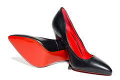 Θηλυκά παπούτσια σε μια άσπρη ανασκόπηση Στοκ εικόνες με δικαίωμα ελεύθερης χρήσης