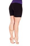 Θηλυκά πόδια σε ένα άσπρο υπόβαθρο Στοκ Εικόνες