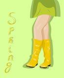 Θηλυκά πόδια στις κίτρινες μπότες Στοκ Φωτογραφίες