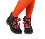 Θηλυκά πόδια στο πορτοκάλι Στοκ Εικόνες