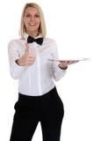 Θηλυκή ξανθή νέα εξυπηρέτηση γυναικών σερβιτόρων σερβιτορών με το resta δίσκων Στοκ Φωτογραφία