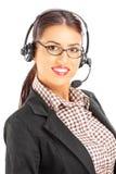 Θηλυκή υποστήριξη πελατών χαμόγελου με τα ακουστικά και το μικρόφωνο Στοκ Φωτογραφία