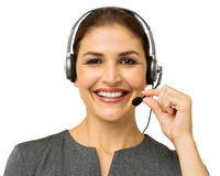 Θηλυκός αντιπρόσωπος εξυπηρέτησης πελατών που μιλά στην κάσκα Στοκ Εικόνα