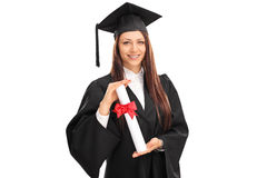 Θηλυκός απόφοιτος φοιτητής που κρατά ένα δίπλωμα Στοκ Εικόνες