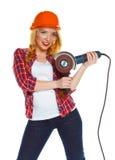 Θηλυκός εργάτης οικοδομών σε ένα σκληρό καπέλο με το μύλο γωνίας Στοκ φωτογραφίες με δικαίωμα ελεύθερης χρήσης