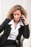 Θηλυκός διευθυντής στο τηλέφωνο Στοκ φωτογραφία με δικαίωμα ελεύθερης χρήσης
