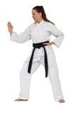 Θηλυκός μαχητής που εκτελεί karate τη θέση Στοκ Φωτογραφίες