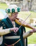 Θηλυκός μουσικός Μεσαιωνική επίδειξη Warkworth, Northumberland Αγγλία UK Στοκ Φωτογραφίες