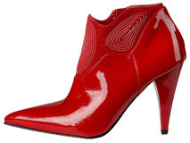 Θηλυκό λαμπρό κόκκινο δίπλωμα ευρεσιτεχνίας-δερμάτινο παπούτσι με το υψηλό τακούνι στοκ φωτογραφία