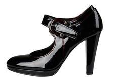 Θηλυκό λαμπρό μαύρο δίπλωμα ευρεσιτεχνίας-δερμάτινο παπούτσι με το υψηλό τακούνι Στοκ φωτογραφία με δικαίωμα ελεύθερης χρήσης