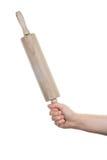 Θηλυκό χέρι με την ξύλινη κυλώντας καρφίτσα Στοκ εικόνες με δικαίωμα ελεύθερης χρήσης