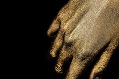Θηλυκό χρυσό χέρι Στοκ εικόνες με δικαίωμα ελεύθερης χρήσης