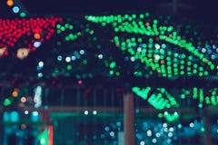 Θολωμένη σύσταση πολλοί πράσινοι και υπόβαθρο κόκκινων φώτων bokeh στη νύχτα στοκ εικόνα με δικαίωμα ελεύθερης χρήσης
