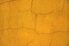 Θολωμένος παλαιός γρατσουνισμένος επικονιασμένος πορτοκάλι τοίχος σπιτιών κλείστε επάνω Στοκ φωτογραφία με δικαίωμα ελεύθερης χρήσης