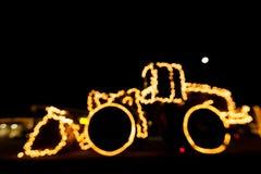 Θολωμένος φορτωτής ροδών που διακοσμείται με τα φω'τα/bokeh φω'τα σε ένα whe Στοκ εικόνες με δικαίωμα ελεύθερης χρήσης