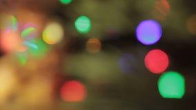 Θολωμένο Χριστούγεννα υπόβαθρο με τα μπισκότα και φιλμ μικρού μήκους