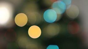 Θολωμένοι ζωηρόχρωμοι κύκλοι bokeh των φω'των Χριστουγέννων απόθεμα βίντεο
