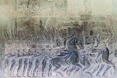 Θρησκευτικές γλυπτικές στους τοίχους Angkor Wat Στοκ φωτογραφία με δικαίωμα ελεύθερης χρήσης