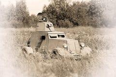 Θωρακισμένο αυτοκίνητο Γερμανικός στρατιωτικός εξοπλισμός από το δεύτερο παγκόσμιο πόλεμο στην αναδημιουργία του πεδίου μάχης για στοκ εικόνες με δικαίωμα ελεύθερης χρήσης
