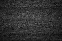 Θλιβερό υπόβαθρο, μαύρος τουβλότοιχος της σκοτεινής σύστασης πετρών Στοκ Εικόνες