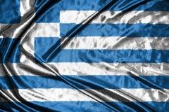διαθέσιμο διάνυσμα ύφους της Ελλάδας γυαλιού σημαιών σημαία στο υπόβαθρο Στοκ Εικόνα