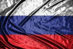 διαθέσιμο διάνυσμα ύφους της Ρωσίας γυαλιού σημαιών σημαία στο υπόβαθρο Στοκ Φωτογραφίες