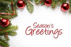 Διακοσμήσεις Χριστουγέννων με τους χαιρετισμούς ` εποχής ` s χαιρετισμού ` Στοκ Φωτογραφίες