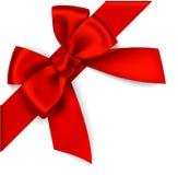 Διακοσμητικό κόκκινο τόξο με διαγώνια την κορδέλλα στη γωνία Στοκ εικόνες με δικαίωμα ελεύθερης χρήσης