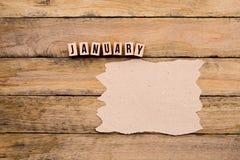 Ιανουάριος - ημερολογιακός μήνας στα ξύλινα κεφαλαία γράμματα με το χειροποίητο π Στοκ Φωτογραφία