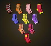 διανυσματικές ζωηρόχρωμες κάλτσες ένα τρίγωνο στο καφετί υπόβαθρο Στοκ Φωτογραφία