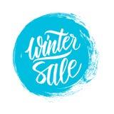 διανυσματικός χειμώνας κειμένων πώλησης ανασκόπησης Ειδικό έμβλημα προσφοράς με το χειρόγραφα σχέδιο κειμένων και το κτύπημα βουρ Στοκ Φωτογραφία