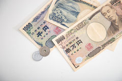 Ιαπωνικά τραπεζογραμμάτια γεν και ιαπωνικό νόμισμα γεν Στοκ εικόνες με δικαίωμα ελεύθερης χρήσης