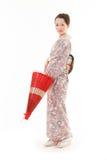 Ιαπωνική γυναίκα κιμονό με την κόκκινη παραδοσιακή ομπρέλα Στοκ Εικόνα