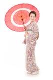 Ιαπωνική γυναίκα κιμονό με την κόκκινη παραδοσιακή ομπρέλα Στοκ φωτογραφία με δικαίωμα ελεύθερης χρήσης
