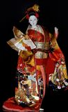Ιαπωνική κούκλα στα εθνικά ενδύματα Στοκ Φωτογραφίες