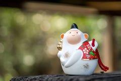 Ιαπωνική τυχερή γοητεία κουδουνιών πιθήκων στοκ φωτογραφία