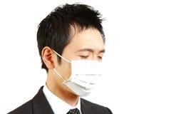 Ιαπωνικός επιχειρηματίας με τη μάσκα Στοκ Εικόνες