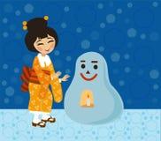Ιαπωνικό κορίτσι κοντά σε έναν παραδοσιακό χιονάνθρωπο Στοκ φωτογραφία με δικαίωμα ελεύθερης χρήσης