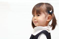 Ιαπωνικό κορίτσι στο επίσημο σχεδιάγραμμα ένδυσης Στοκ Εικόνες