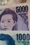 Ιαπωνικό νόμισμα γεν υποβάθρου στο κάθετο πλαίσιο Στοκ φωτογραφία με δικαίωμα ελεύθερης χρήσης