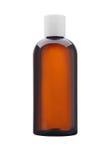 Ιατρική ή καλλυντικό μπουκάλι του καφετιού γυαλιού ή απομονωμένου του πλαστικό ο Στοκ Φωτογραφίες